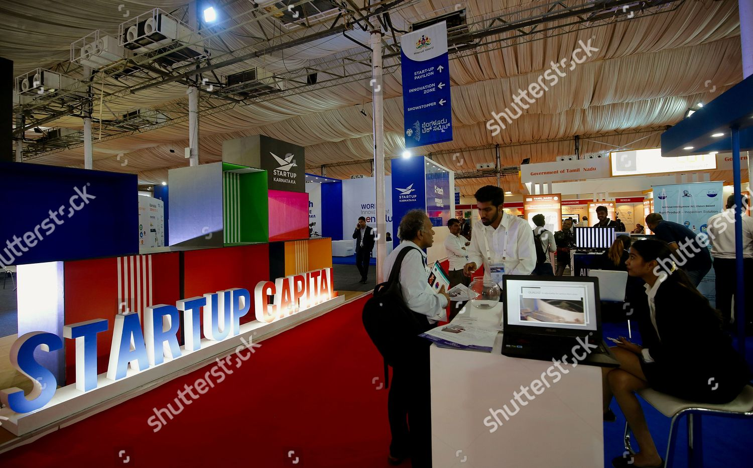 Exhibition Stall In Bangalore : Visitors inspect exhibition stall during 21st edition editorial