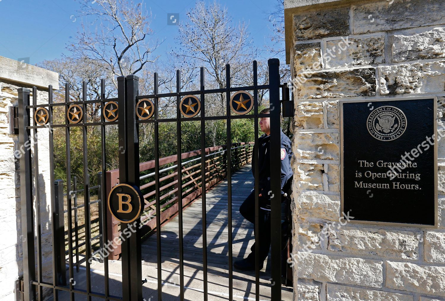 Police Officer Stands Guard Gate Leading Grave Stock Photo