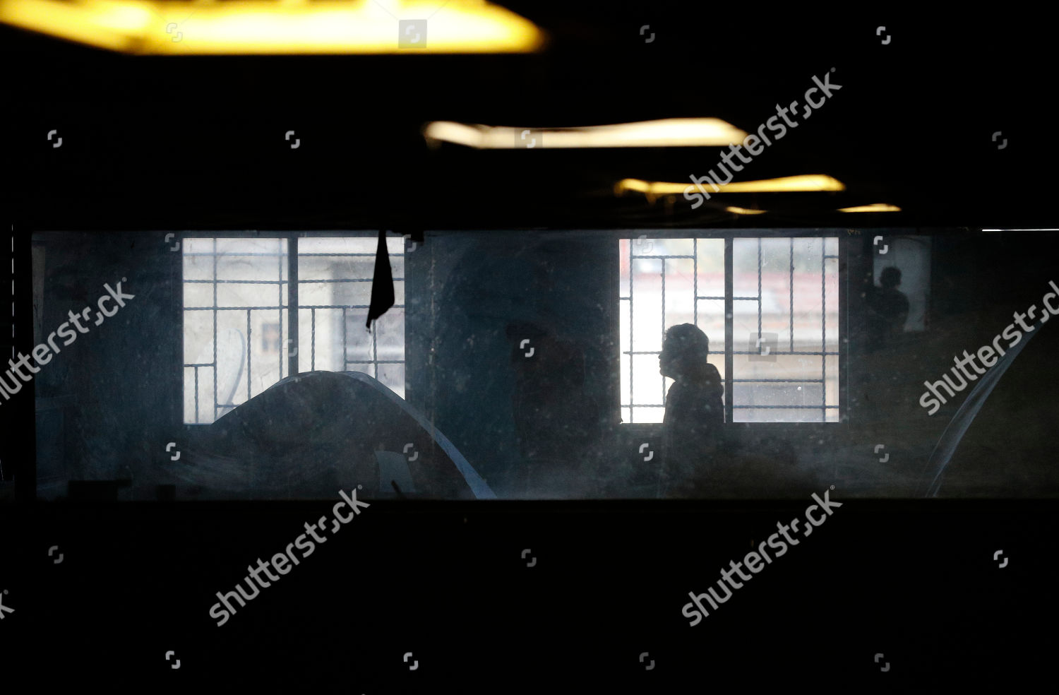 Migrants camp out inside former concert venue Editorial Stock Photo