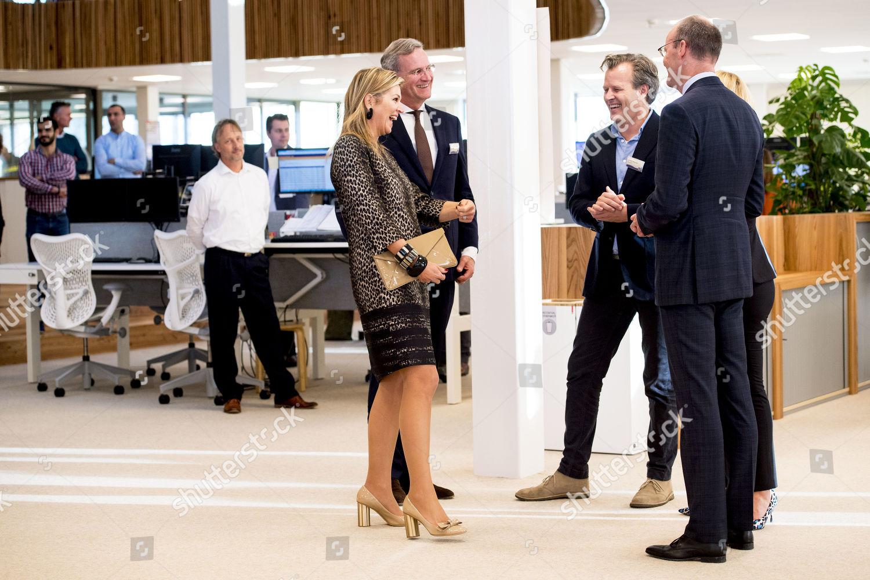 queen-maxima-at-a-working-visit-to-eosta-waddinxveen-niederlande-shutterstock-editorial-10013563aj.jpg