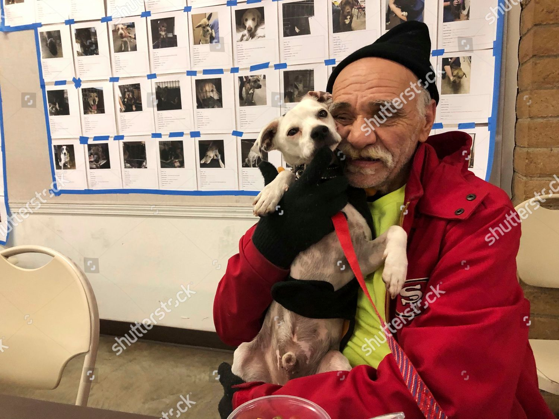 Bob Talk cuddles his dog Princeton Red Editorial Stock Photo