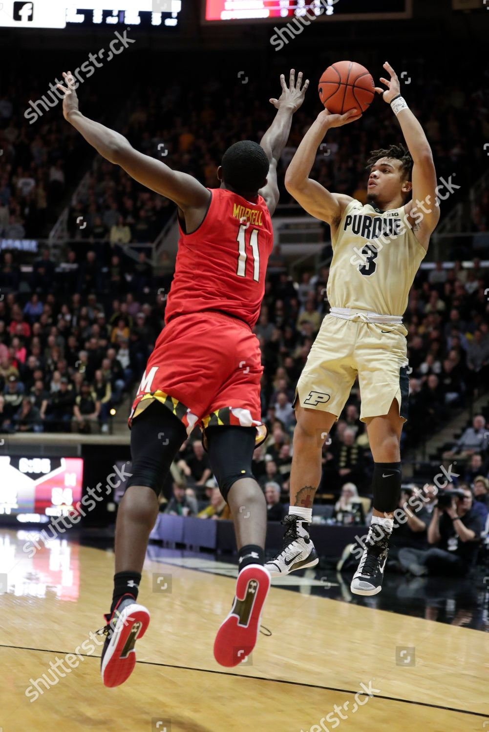 6d45c3beae1 Purdue guard Carsen Edwards 3 shoots over Editorial Stock Photo ...