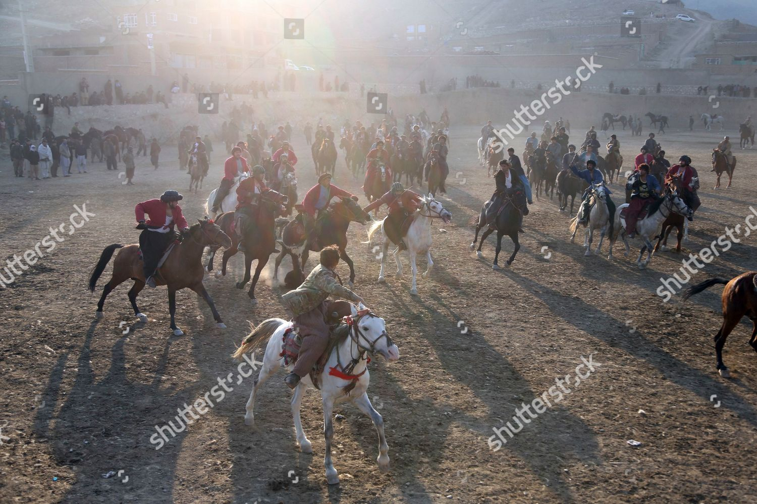 Afghan horse riders compete goat during friendly Editorial