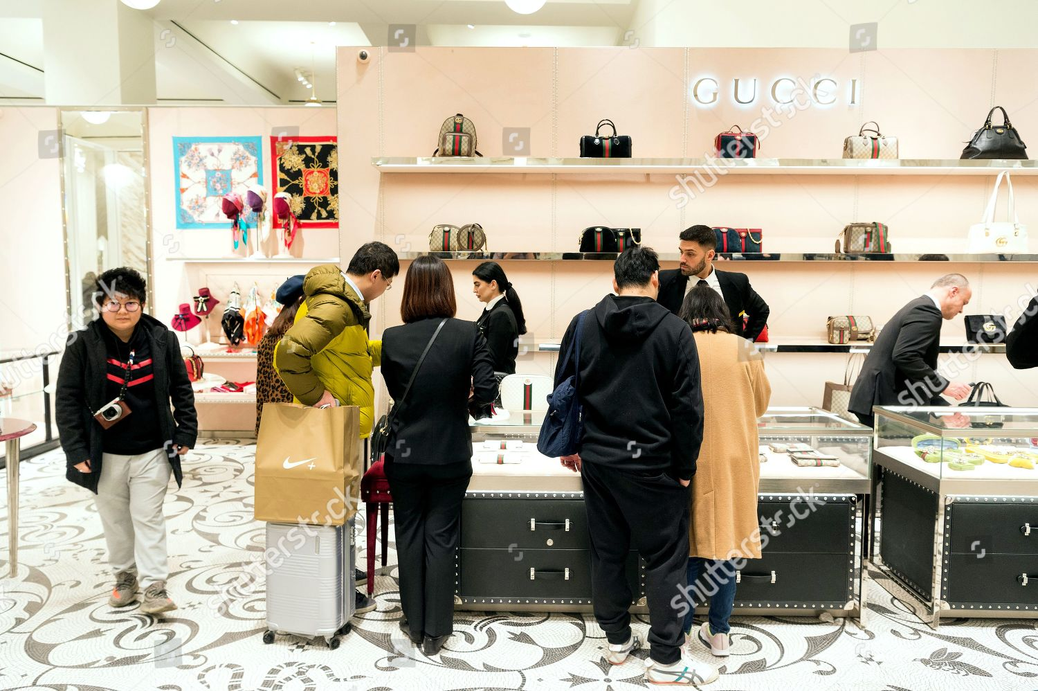 8c21fc33562 Shoppers inside Gucci concession store Selfridges Boxing Editorial ...