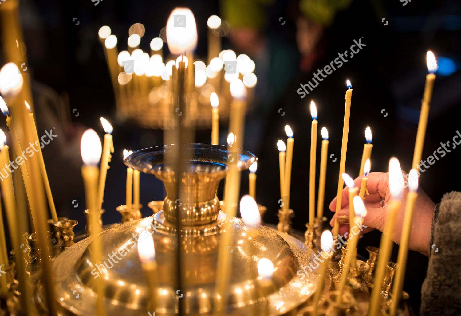 Orthodox Christmas 2019.Lithuanian Orthodox Believer Lights Candles During Liturgy