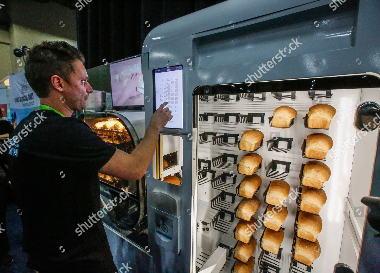 man demonstrates how Wilkinson Baking Companys breadbot Editorial