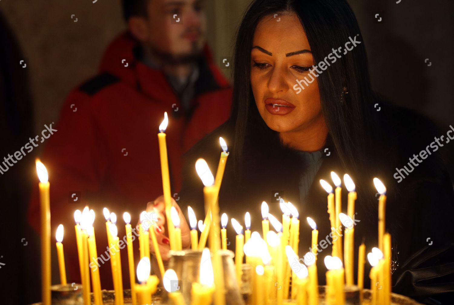 Orthodox Christmas 2019.Orthodox Serb Woman Lights Candles Sarajevo Cathedral