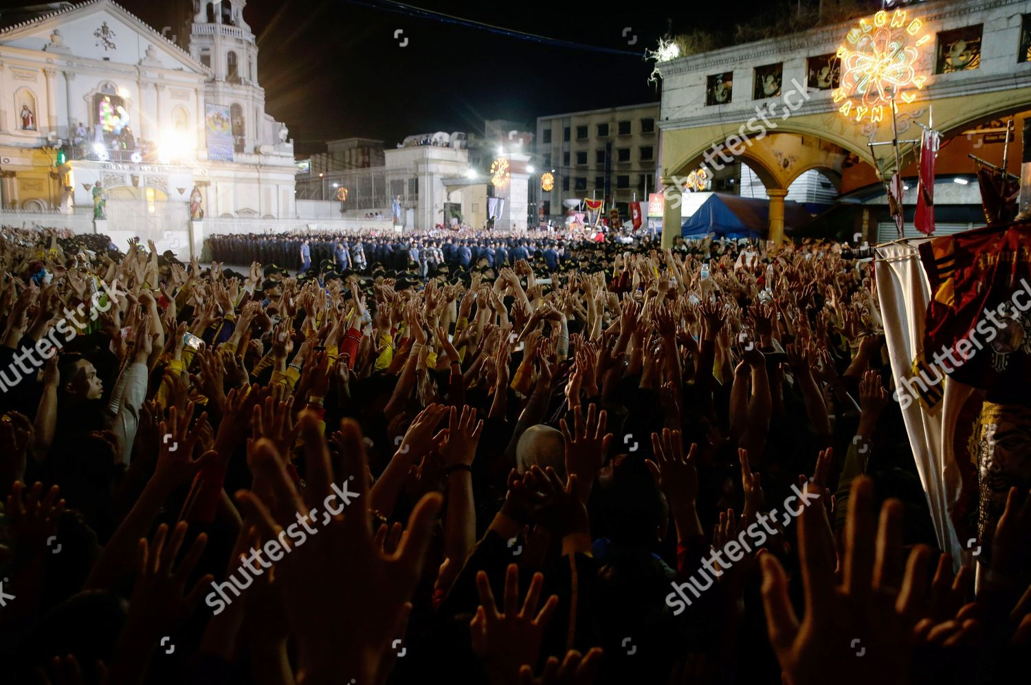 Catholic devotees raise their hands statue Black Editorial