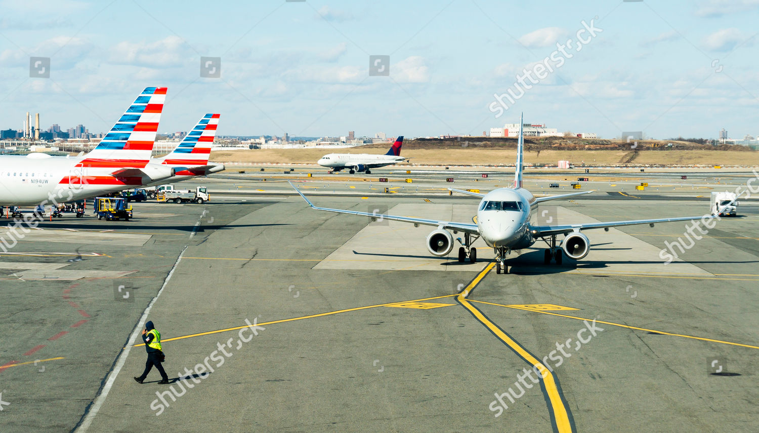 Airplanes pull into out gates LaGuardia airport Editorial