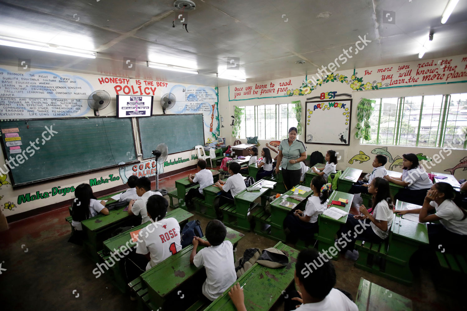 Students attend class government run school using Editorial