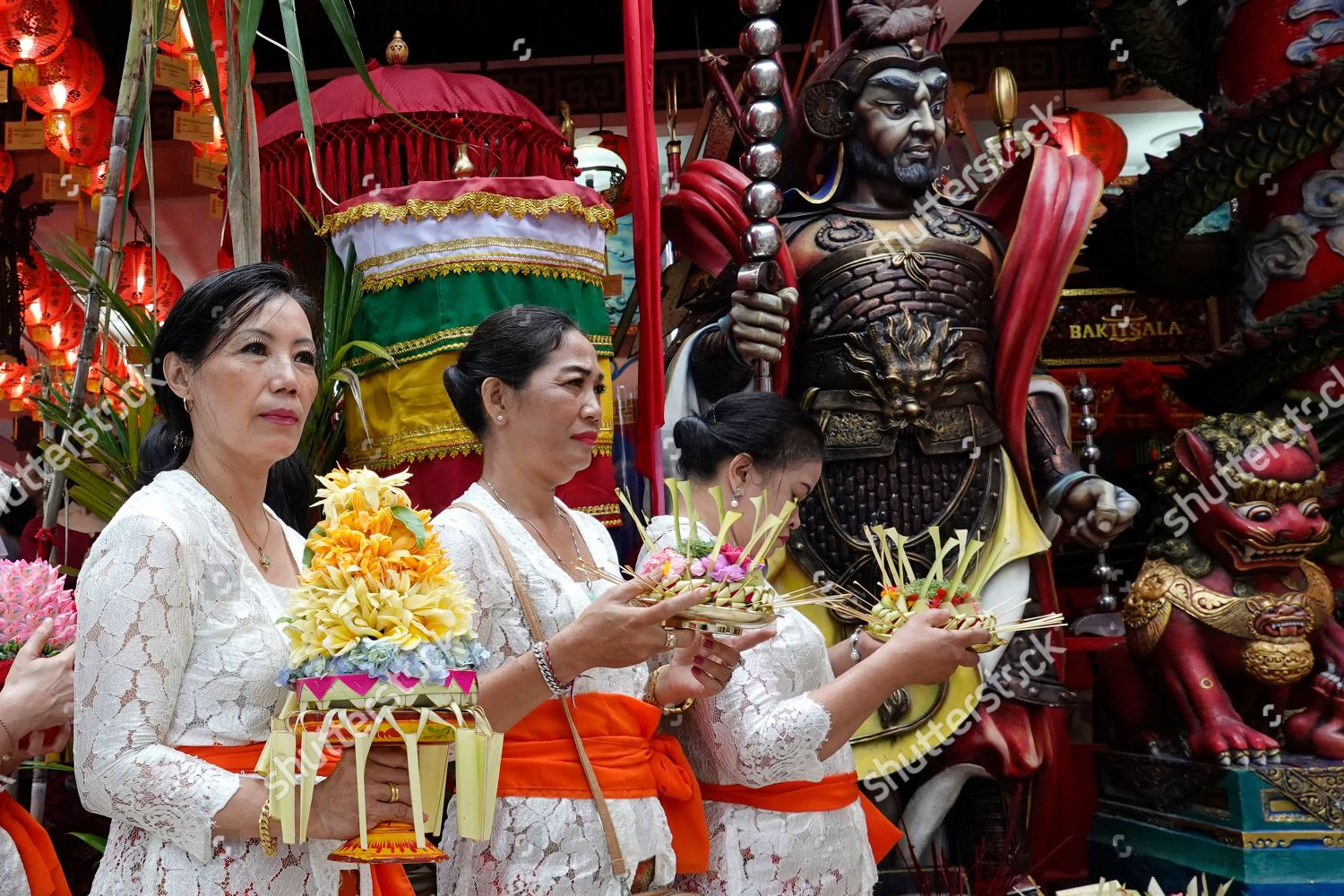 Indonesian Ethnic Chinese People Carry Offerings During