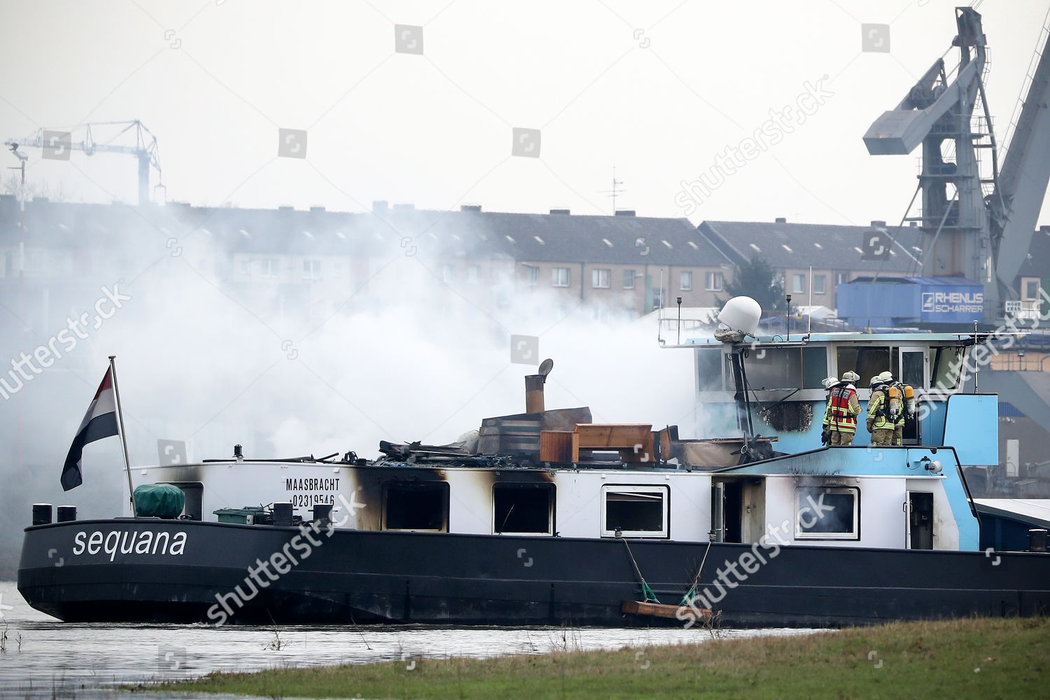 Firefighters inspect parts ship after fire Duisburg