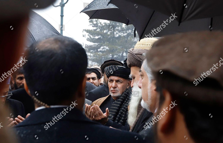 Afghanistans President Mohammad Ashraf Ghani c prays