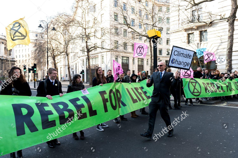Foto stock a tema Extinction Rebellion protest at London Fashion Week, UK - 17 Feb 2019