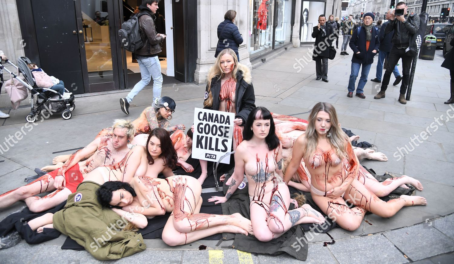 Topless Women Protest Canada Goose's Use Of Coyote Fur In Nyc