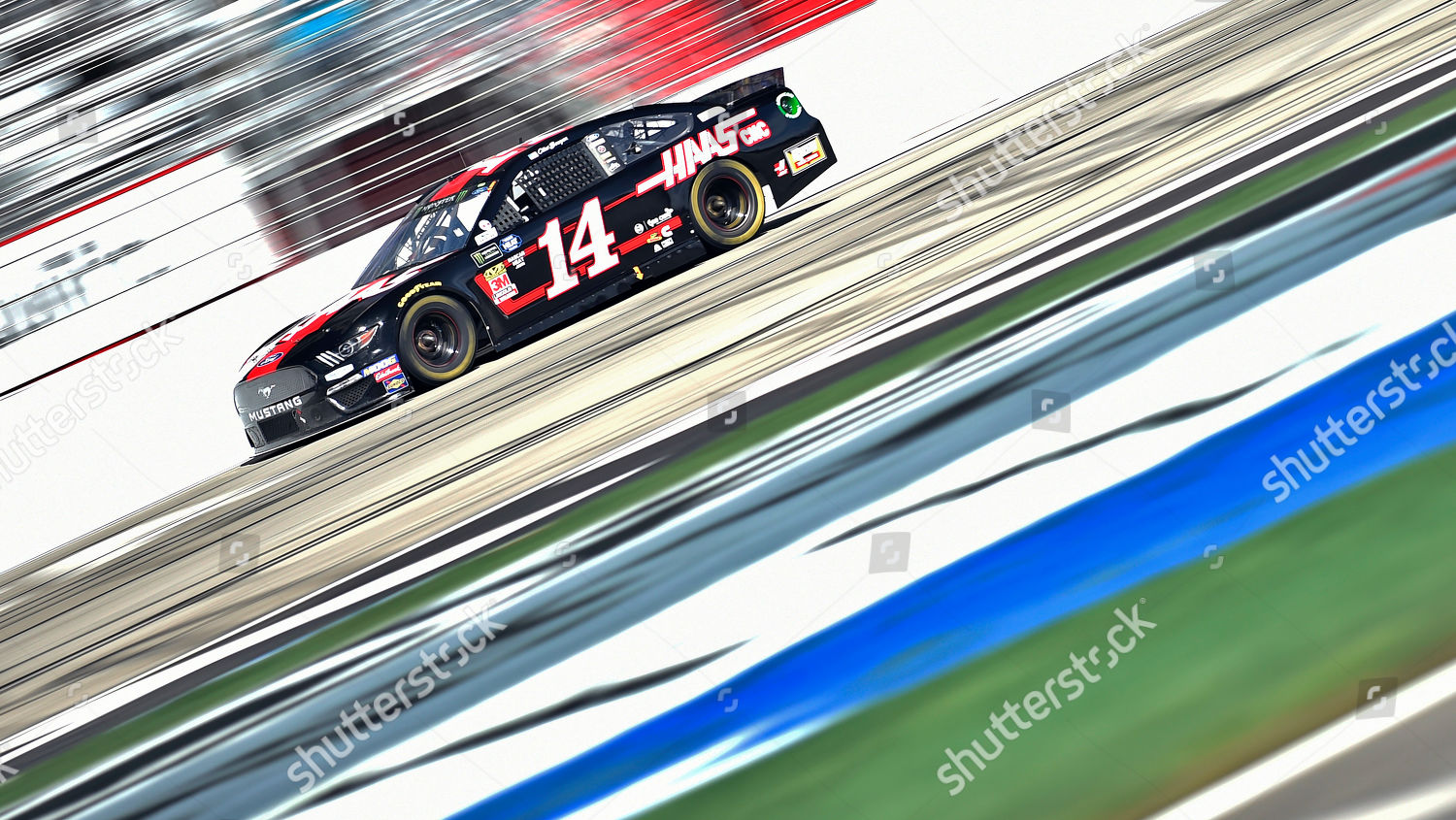 Clint Bowyer races HAAS Ford down front Editorial Stock