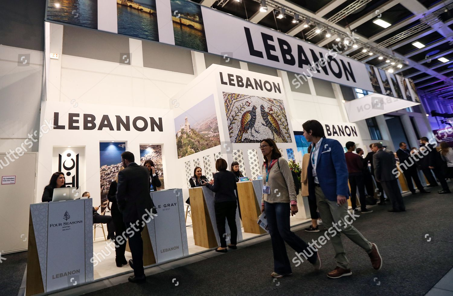 Visitors walk past stand Lebanon International Travel Editorial