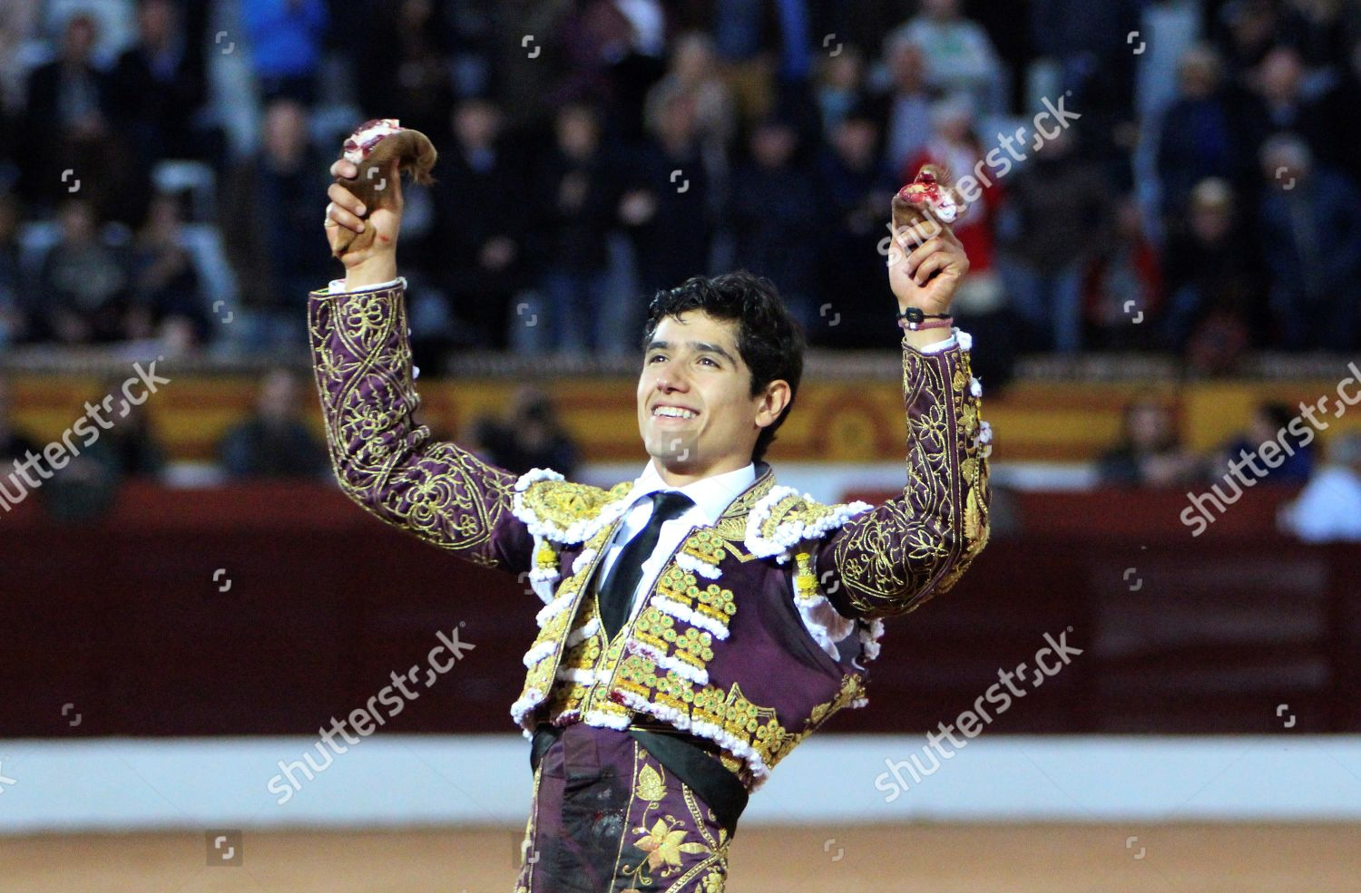 Mexican bullfighter Luis David Adame holds two Editorial Stock Photo