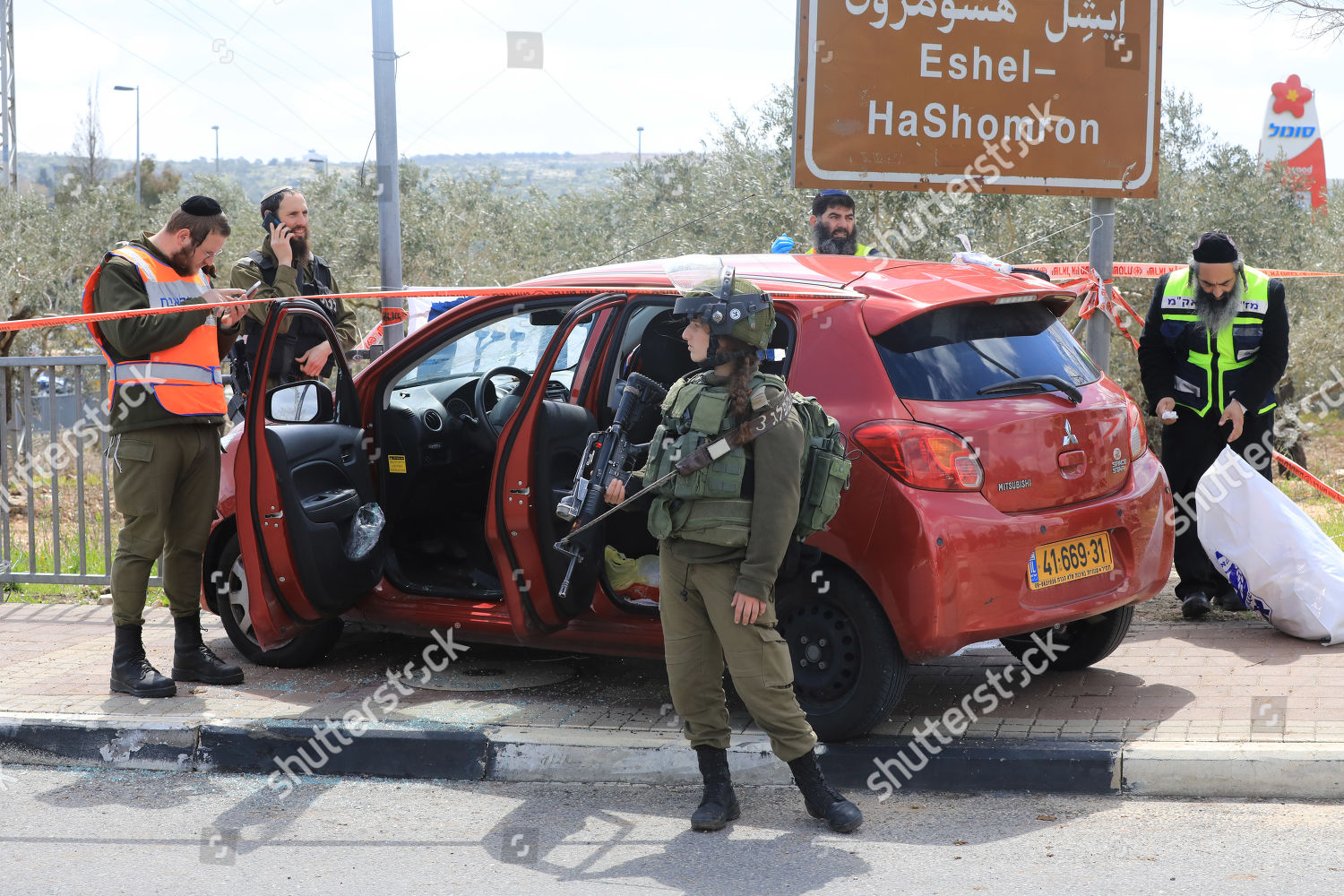 Israeli forensic experts security personnel inspect car Editorial