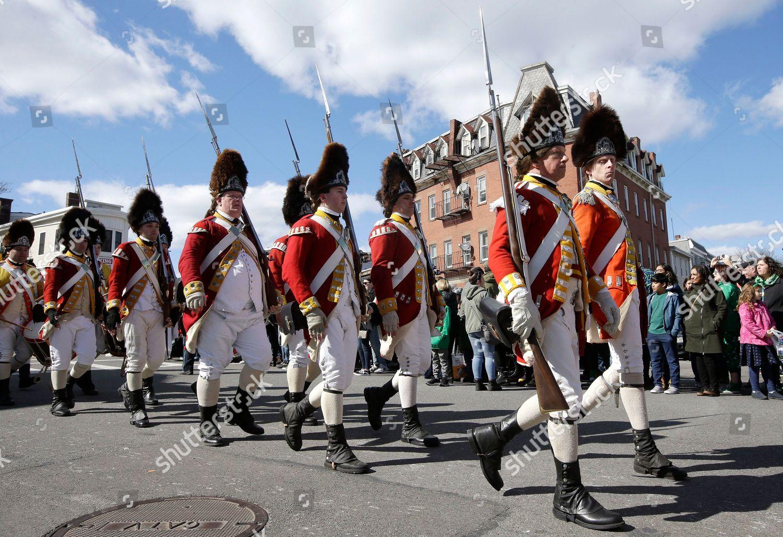 Revolutionary War reenactors British uniforms march annual
