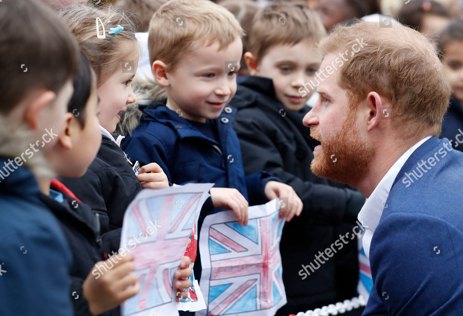 Prince Harry smiles he talks pupils St Editorial Stock Photo