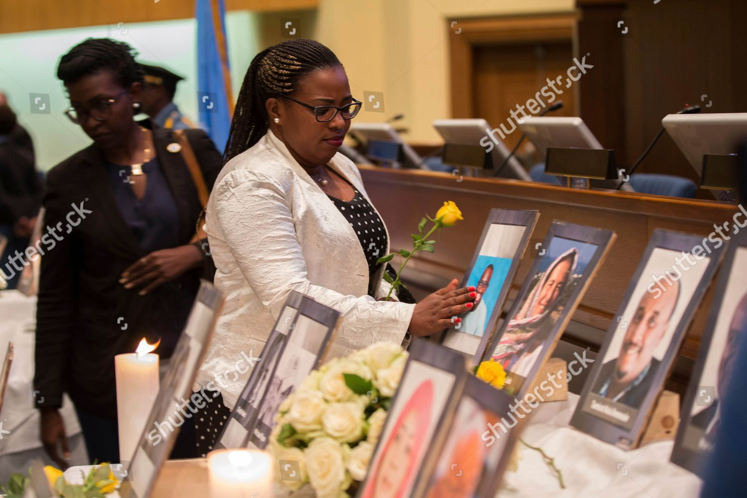 People attend Memorial UN NGO personnel Addis Editorial