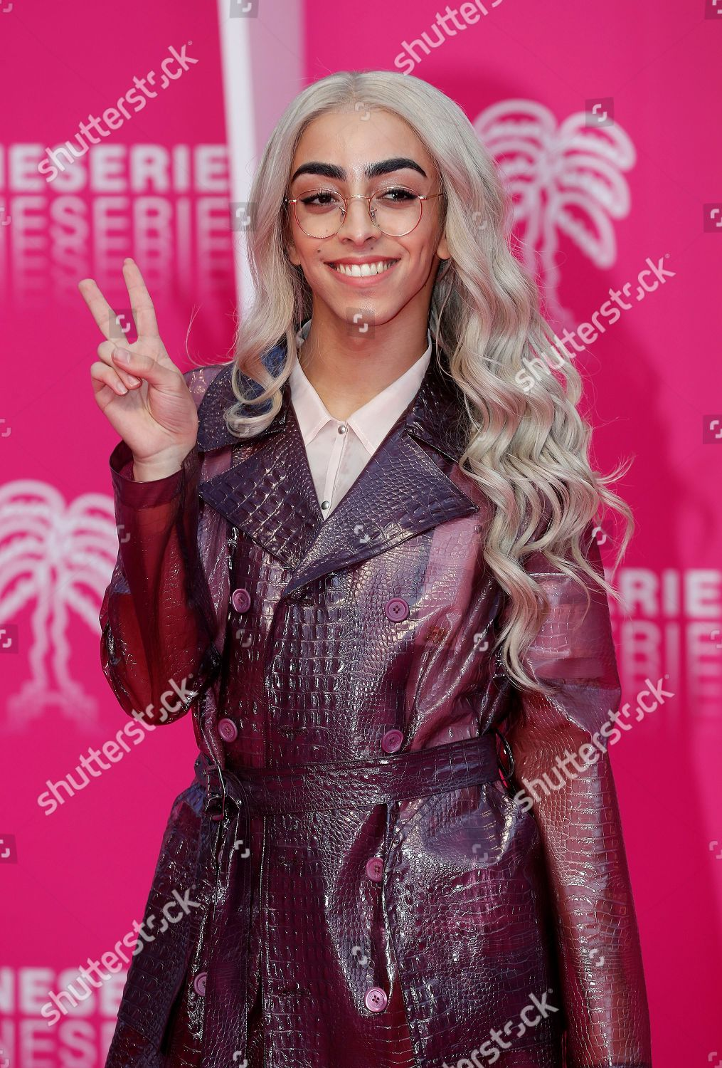 French singer Bilal Hassani poses on pink Editorial Stock Photo