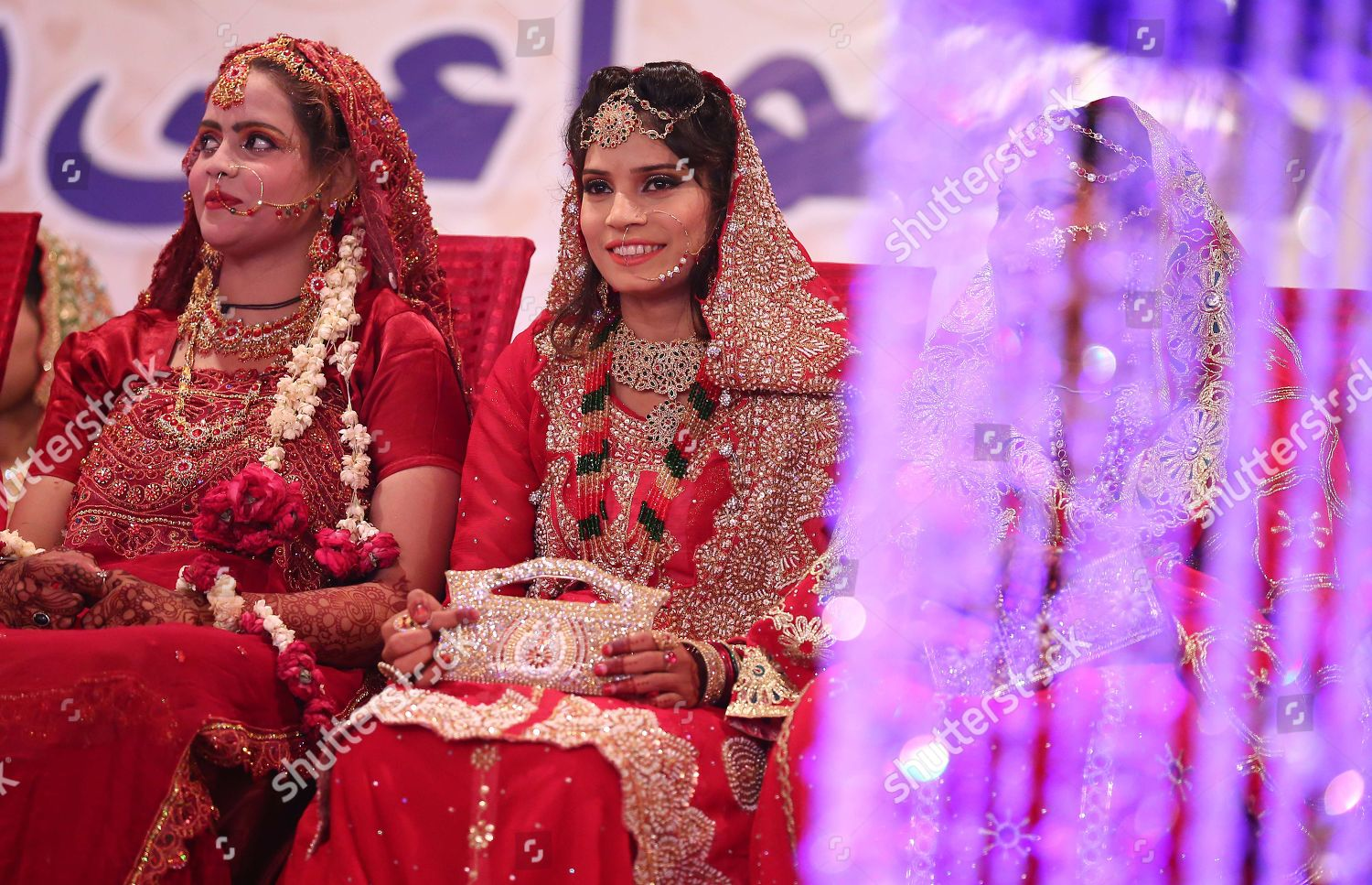 Pakistani brides attend their wedding during mass Editorial Stock
