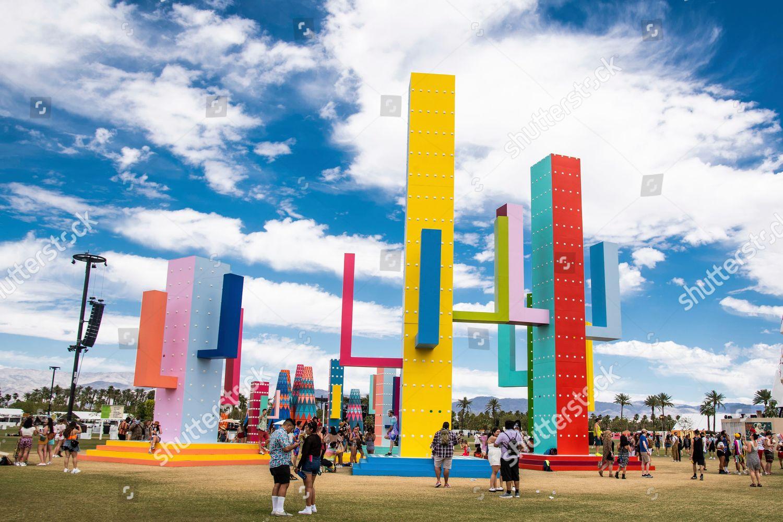 Festival goers seen art installation Colossal Cacti
