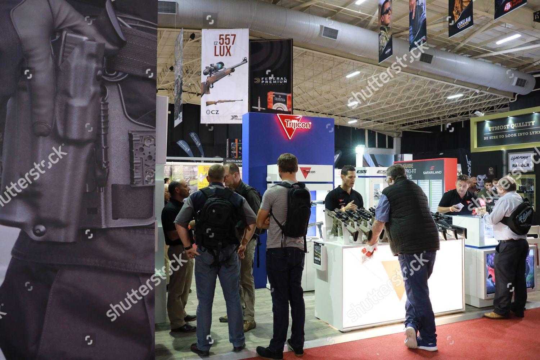 Visitors look weapons during annual Huntex held Editorial Stock