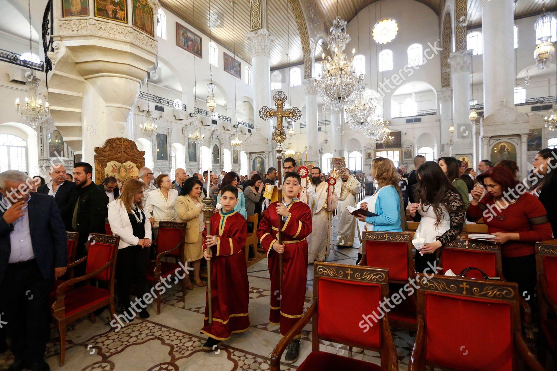 Syrian Romans Orthodox pray during mass mark Editorial Stock