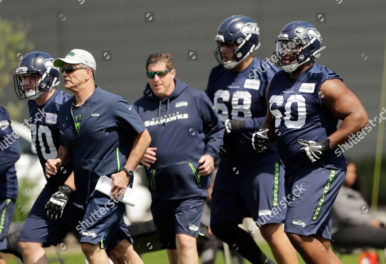 e50917fcb04 Seattle Seahawks guard Phil Haynes right runs Editorial Stock Photo ...
