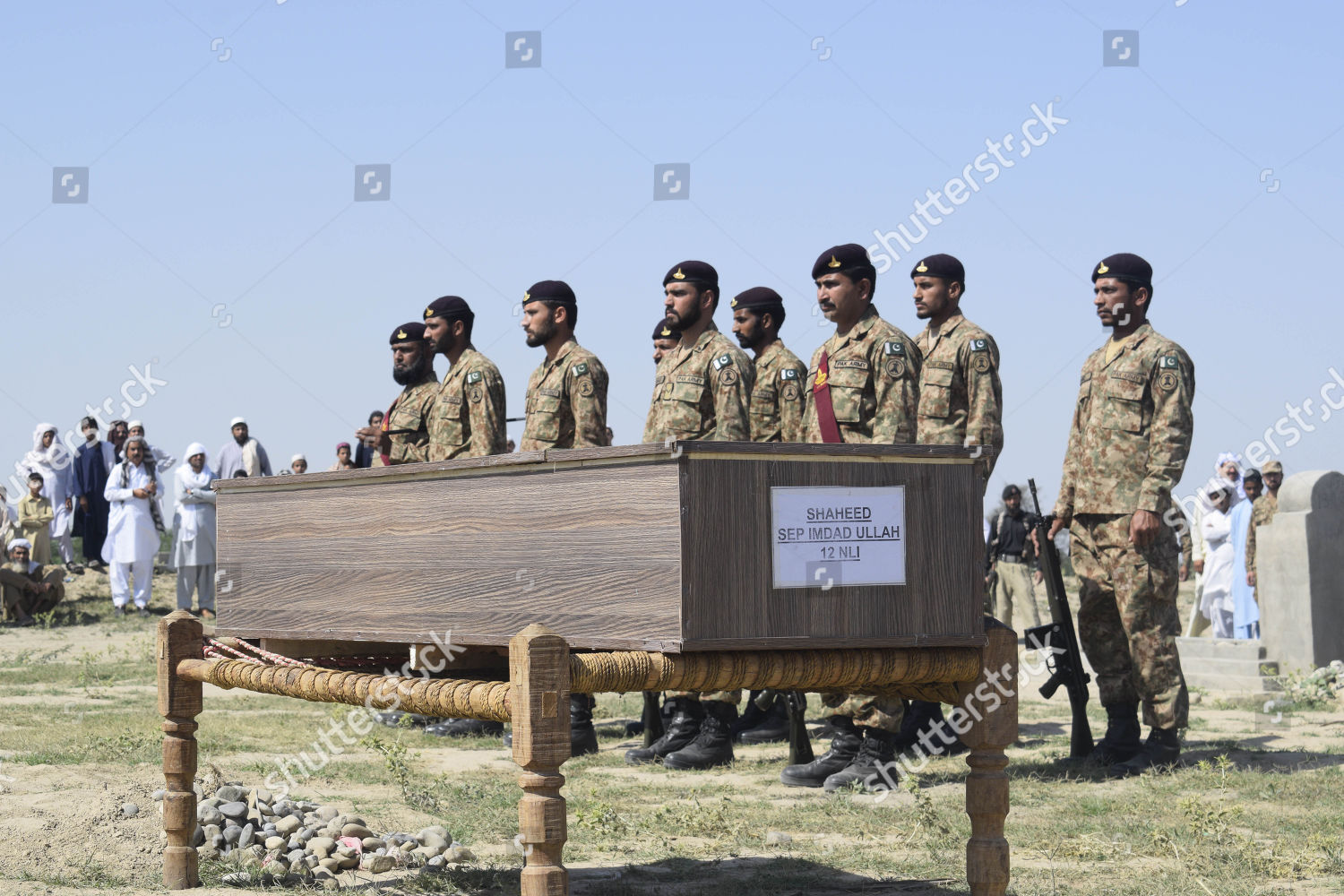 Pakistani Army soldiers attend burial their comrade Editorial Stock