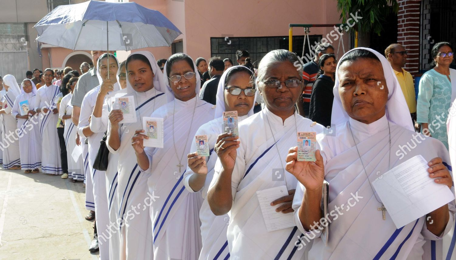 Nuns Catholic missionary stand queue cast their Editorial