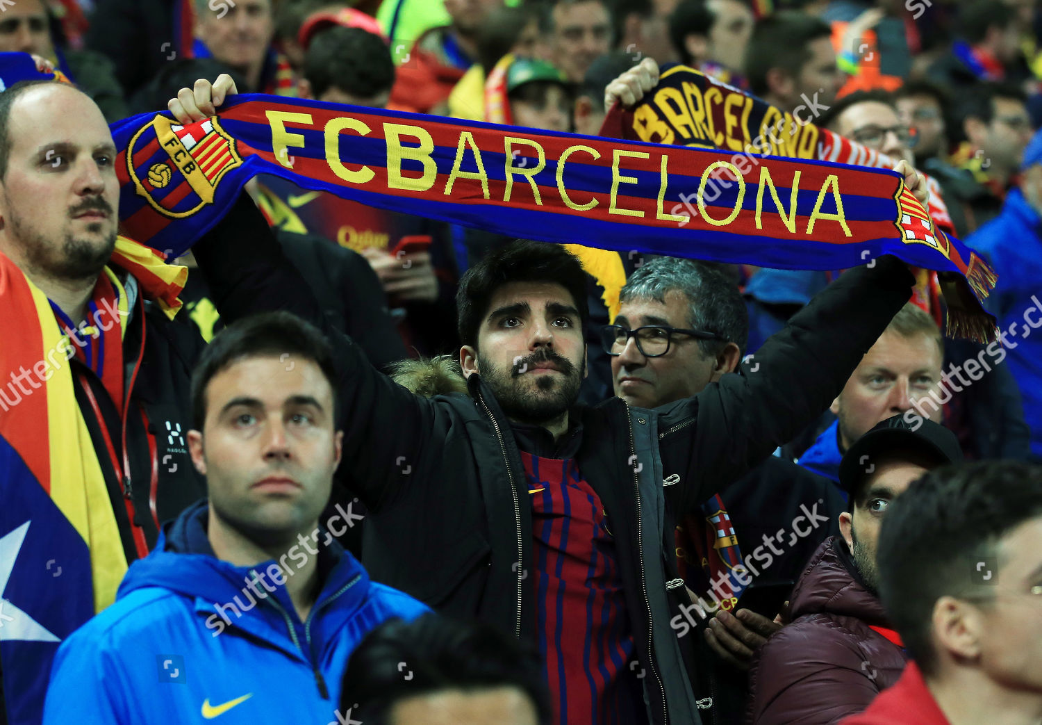 Barcelona fan holds his scarf end game Editorial Stock Photo