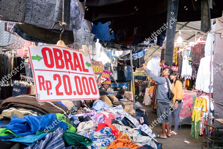 man shops clothes street stall Denpasar Bali Editorial Stock Photo