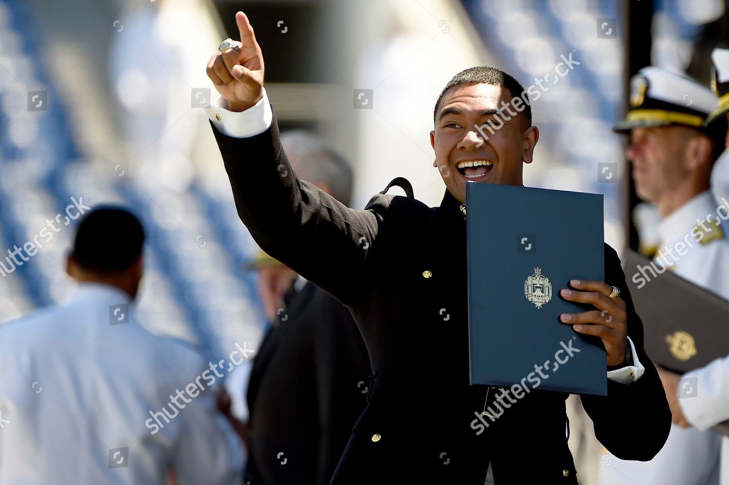 Naval Academy graduate celebrates after receiving their