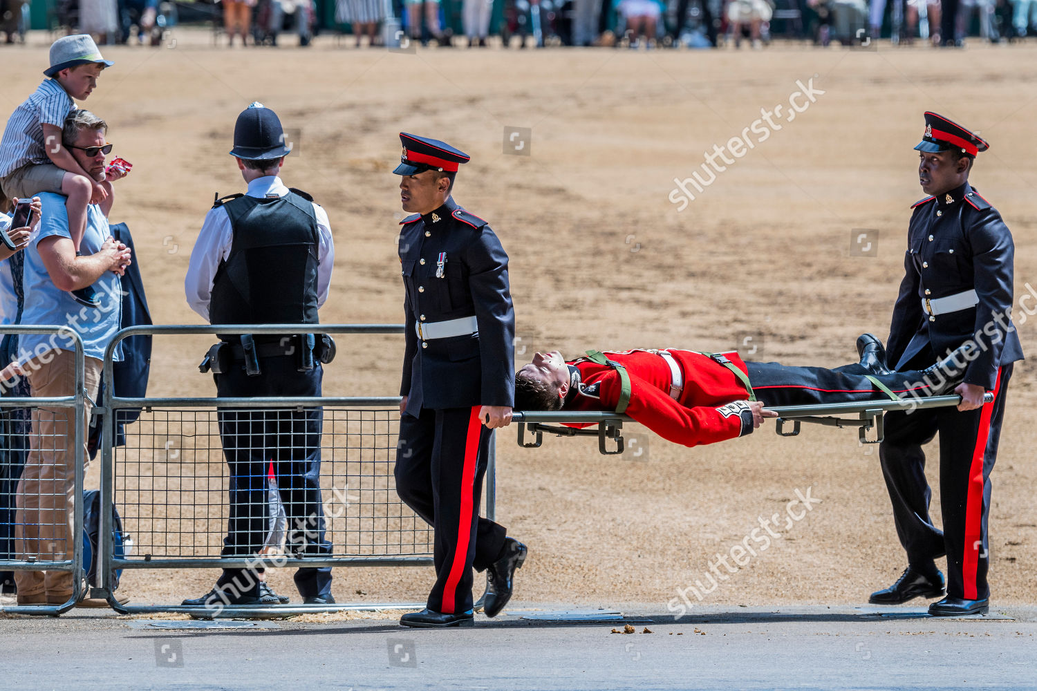Two guardsmen faint stretchered off Editorial Stock Photo