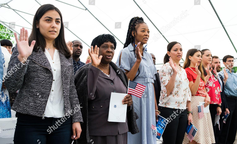 New citizens recite United States Oath Allegiance Editorial