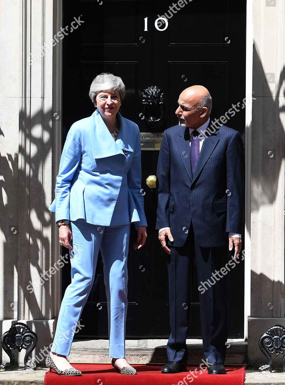 British Prime Minister Theresa May L welcomes Editorial