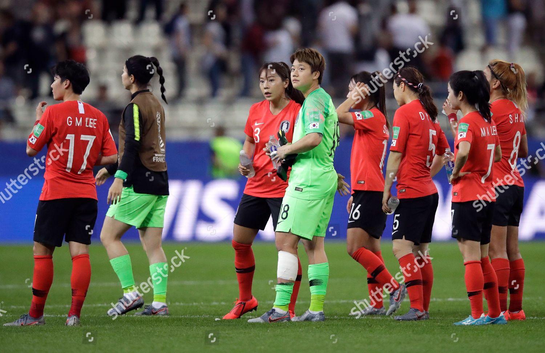 South Korean players react following their teams Editorial