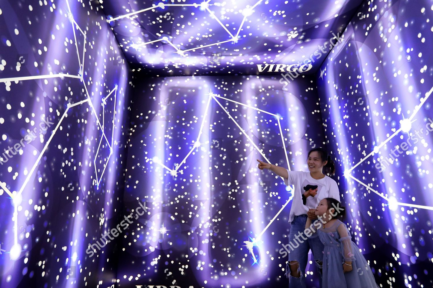 Visitors experience interactive light shadow installation 4D