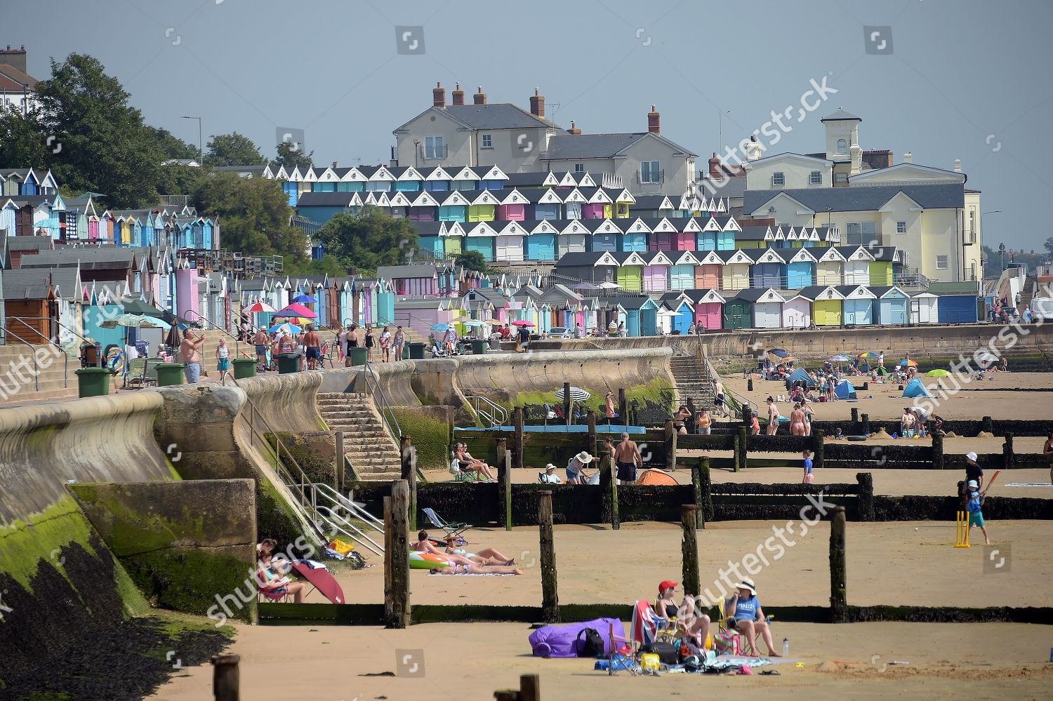 People sunbathing Walton on Naze Essex Editorial Stock Photo