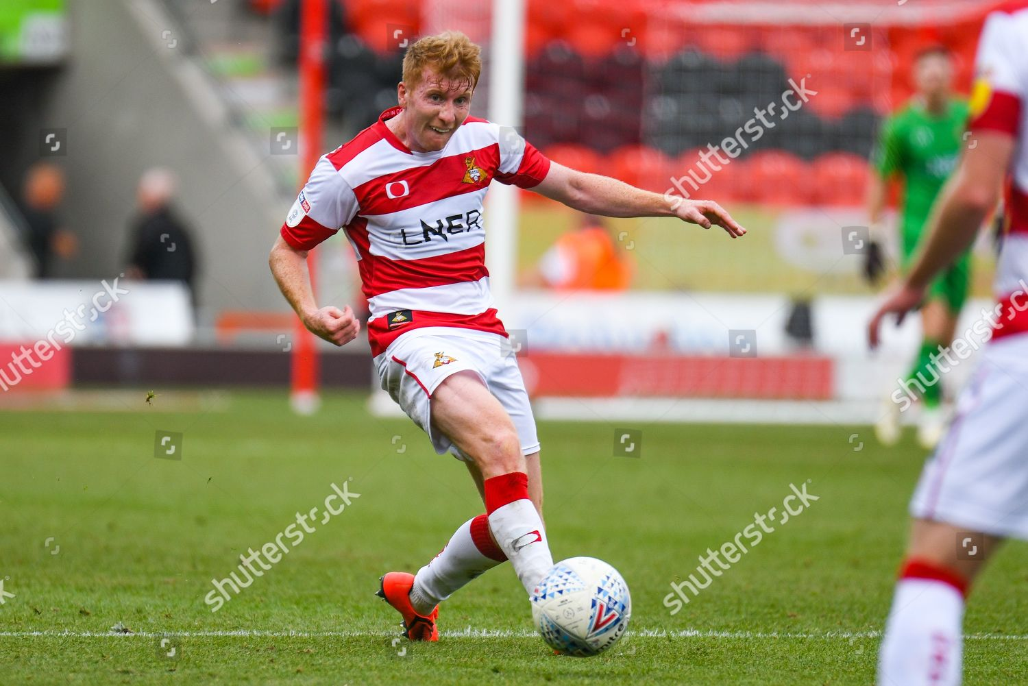 Brad Halliday Doncaster Rovers 2 passes ball Editorial Stock