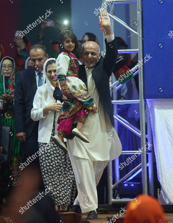 Afghan presidential candidate Ashraf Ghani waves his