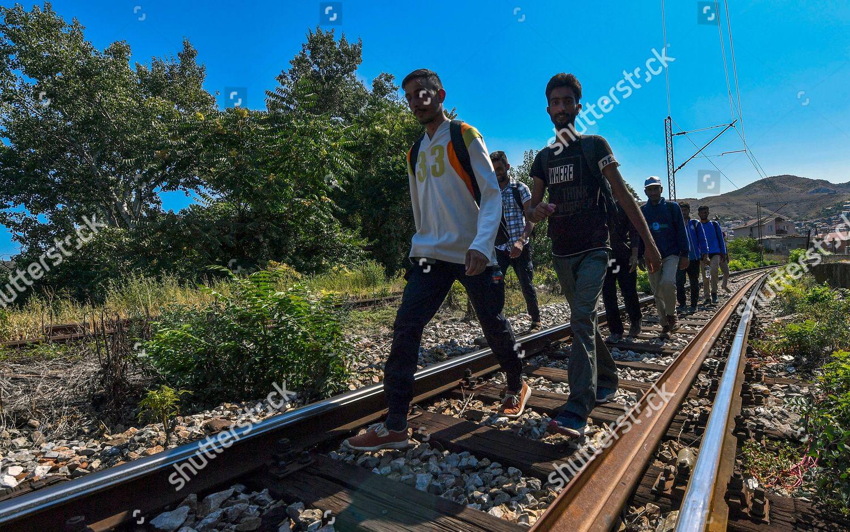group Pakistani illegal migrants walk on railroad Editorial