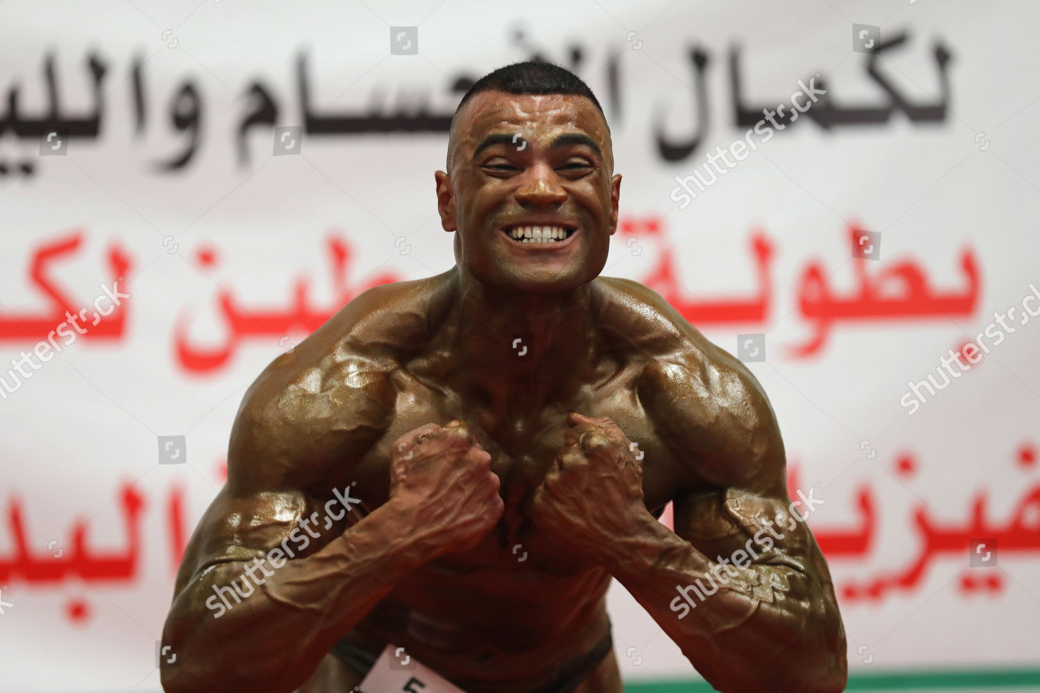 Palestinian bodybuilder flexes his muscles he competes