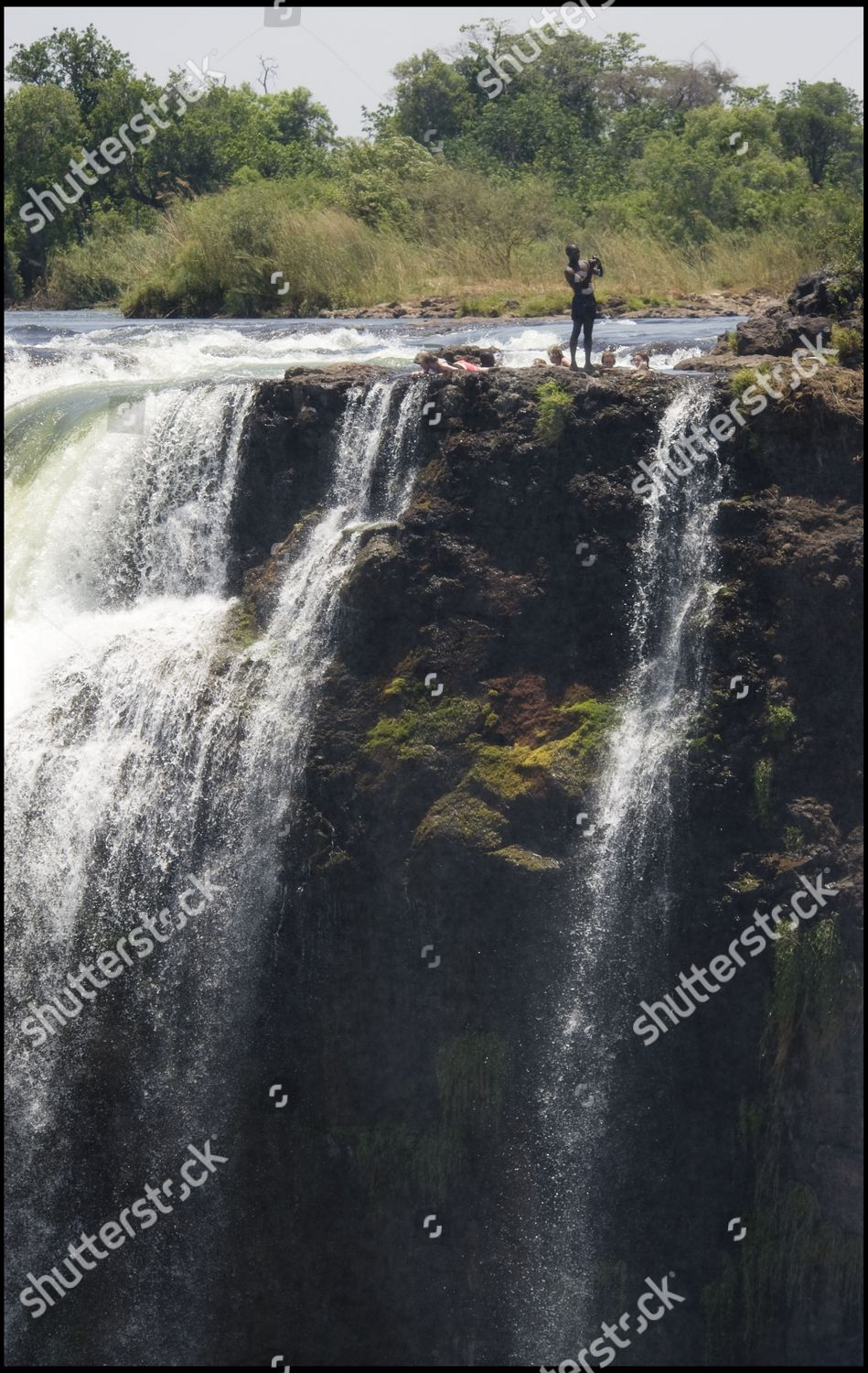 Victoria Falls Zambian Tour Guide Entertains His Editorial Stock