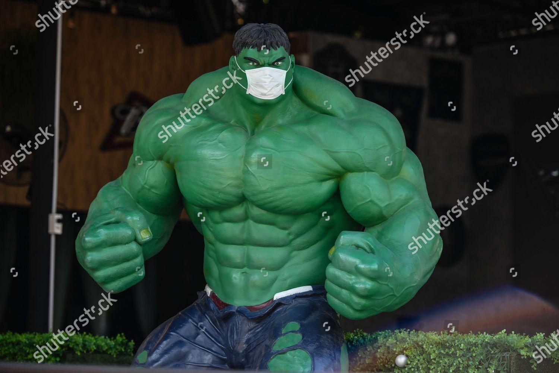 sculpture Incredible Hulk wearing protective mask precautionary Foto  editorial en stock; Imagen en stock | Shutterstock