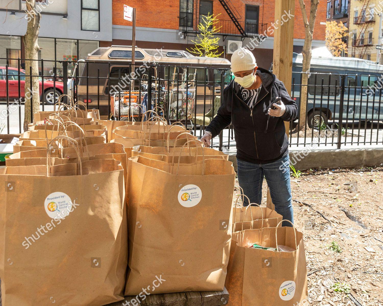 Woman Picks Bag Free Food Amid Covid19 Editorial Stock Photo